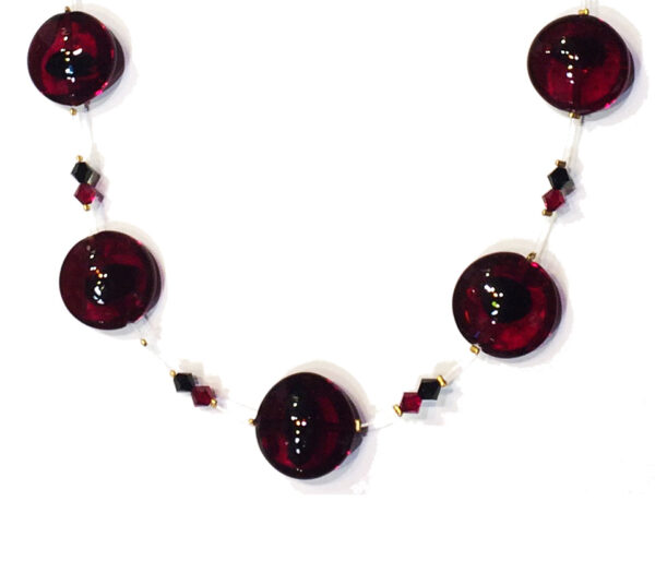 Lampworked beads and original Swarovski elements on a transparent thread.