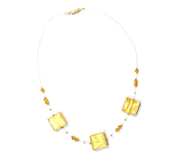 Necklace featuring lampwork Murano glass beads with internal gold leaf and original Swarovski beads on a transprent thread.