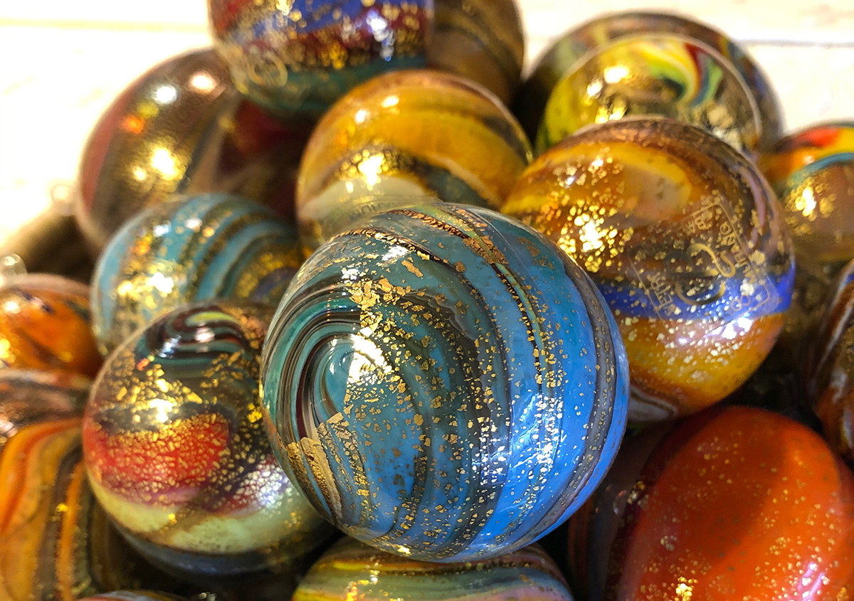 Glass balls with gold leaf